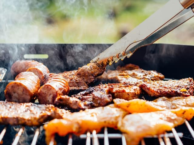 grilled steak and sausages