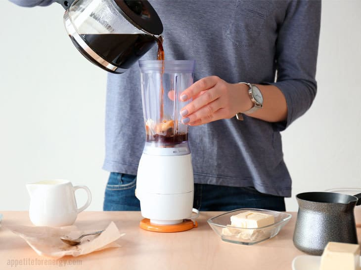 Pouring coffee into blender to make bulletproof coffee