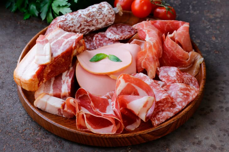 A platter of different meats - salami, proscuitto, ham, pancetta, pepperoni