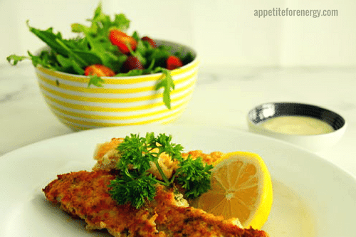 30 Minute Low Carb Herb and Parmesan Crusted Fish, a bowl of salad and garlic aioli
