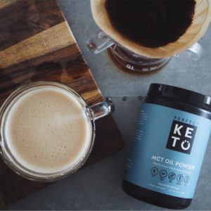 MCT Oil Powder Perfect Keto and a mug of coffee