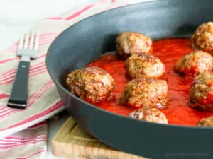 Beef Meatballs Cooking in marinara sauce in skillet