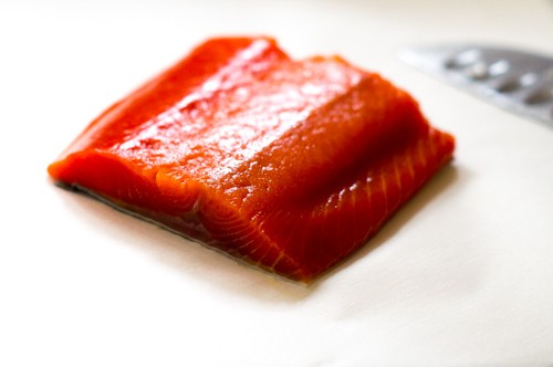 Raw salmon fillet on paper