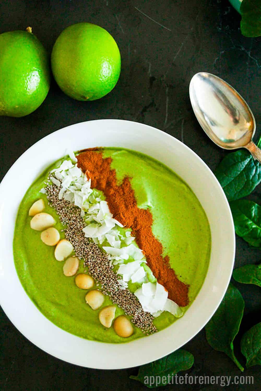 Green Keto Smoothie Bowl topped with macadamias & chia seeds