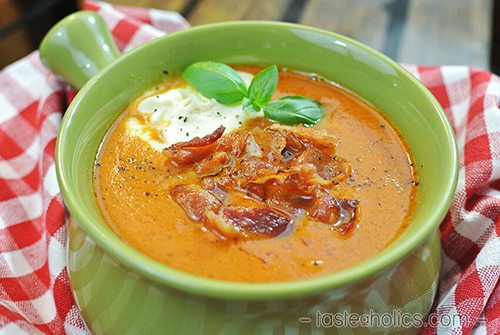 Tomato Soup in a bowl with bacon and sour cream