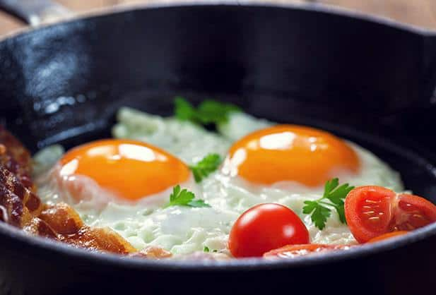 Bacon, eggs and tomatoes in a fry-pan