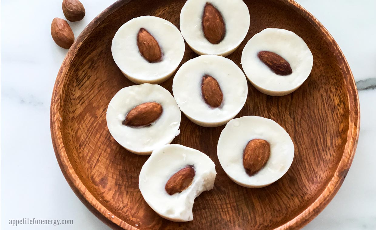 Keto White Chocolate Coconut Fat Bombs on a wooden plate