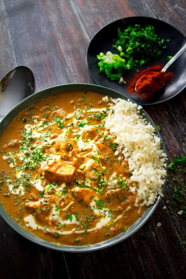 Low-Carb Butter Chicken Curry in a bowl with cauliflower rice