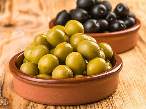 Low-carb snacks - green and black olives