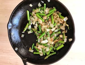 Cooking the asparagus and onions in a frypan