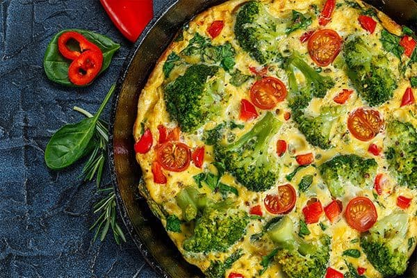 Frittata with broccoli in a frying pan