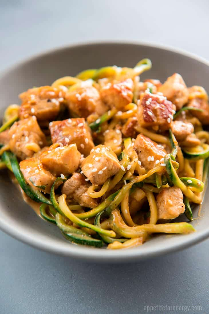 Close up of Crispy Pork LO Mein with Zoodles in a light grey bowl