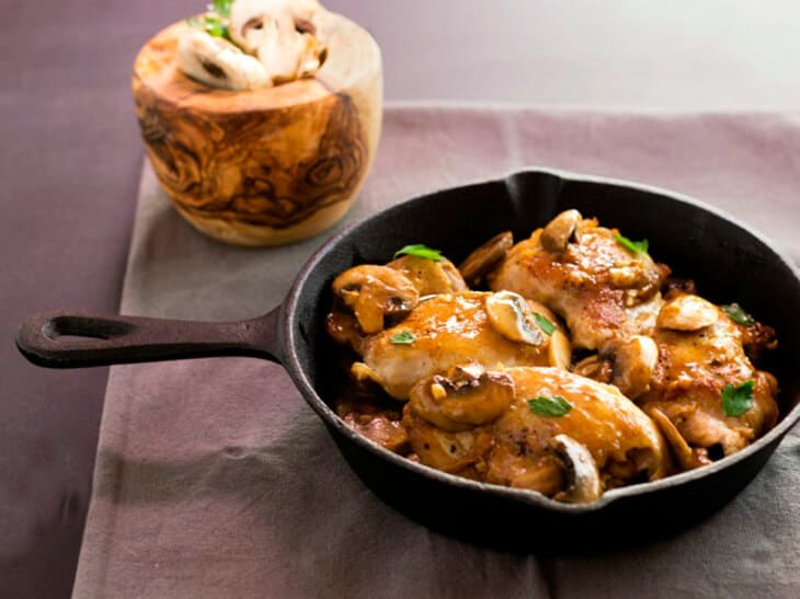 Garlic chicken mushroom saute in a black skillet