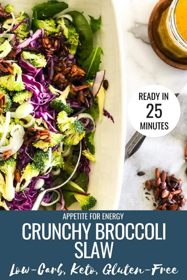 Crunchy Broccoli Slaw in a white serving bowl with nut clusters on a tray and dressing in a jar