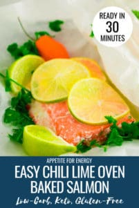 Chili Lime Oven Baked Salmon in the parchment paper that it cooks in, with fresh lime