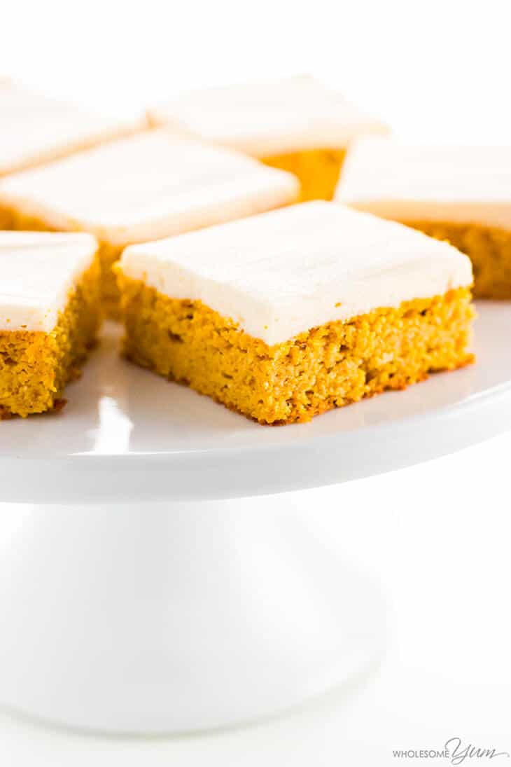 Close up of healthy pumpkin bars with a cream cheese frosting layer on top