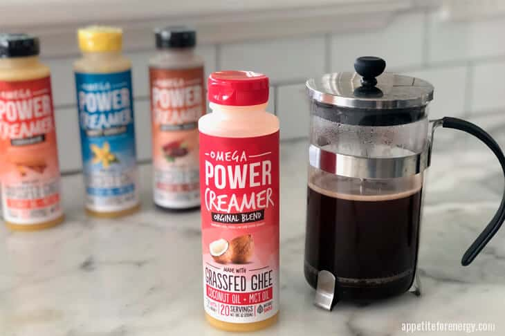 4 Omega Coffee creamer flavors and a pot of black coffee