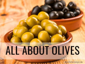 Green olives and black olives in terracotta dishes