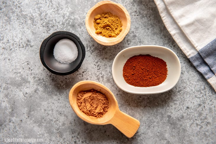 Spices for Keto Chili Con Carne in small bowls