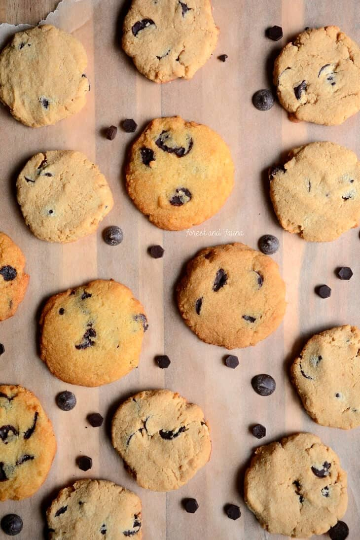 Overhead shot of Chocolate chip cookies on a wooden board