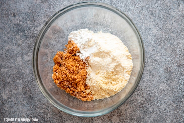 Step 1 Dry ingredients for cinnamon roll muffins in glass bowl