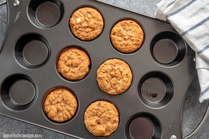 Freshly cooked cinnamon rolls straight from oven in muffin tin
