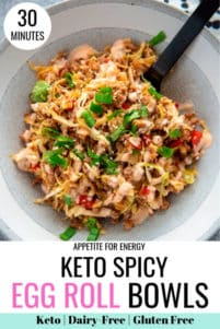 KETO Spicy Egg Roll Bowl in a white bowl with black fork and napkin