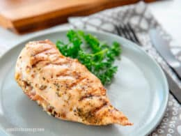 KETO Grilled Mushroom Stuffed Chicken Breast on grey plate with parsley