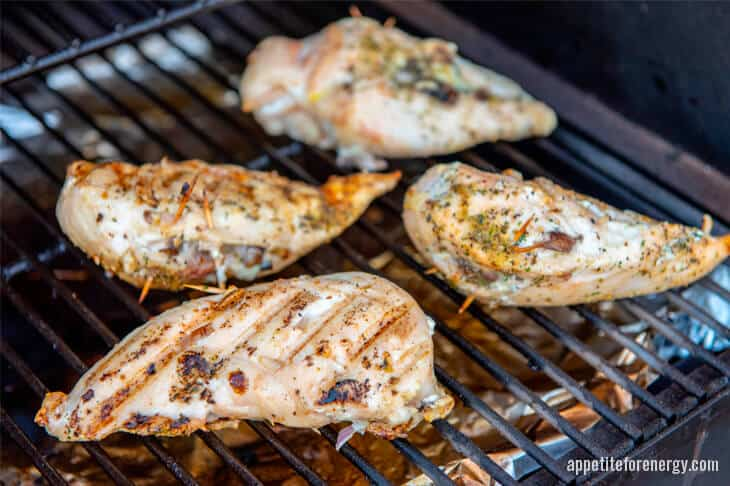 Keto stuffed chicken cooking on grill or barbecue